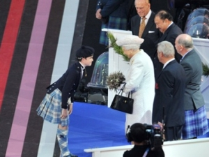 Britain's Queen Elizabeth II And Prince Philip, The Duke of Edinburgh are greeted as they arrive during the opening ceremony of the 2014 Commonwealth Games at Celtic Park in Glasgow on July 23, 2014.  AFP PHOTO/ GLYN KIRKGLYN KIRK/AFP/Getty Images